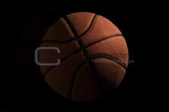 Basketball over black background
