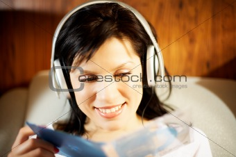 Beautiful woman listening music in headphones