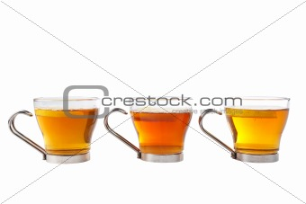 Three glass cups of tea with one slice of lemon