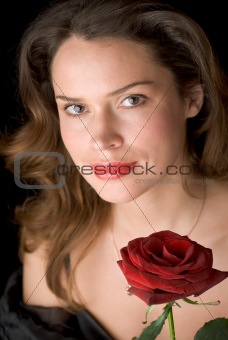 Beautiful lady with red rose. Portrait
