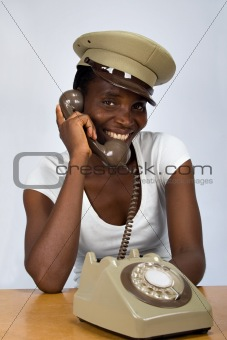 African girl with old phone