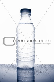 Bottle of mineral water with droplets