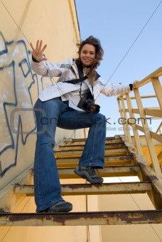 Moman with camera at abandoned stairs