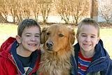 Boys Smiling with Dog