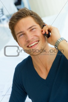 IT executive laughing while talking on his cellular.