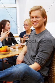 Portrait of a young man in front of a workgroup