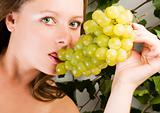 Beautiful Woman portrait with green grape