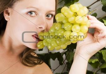Beautiful Woman portrait with green grape