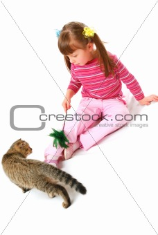 Little girl playing with kitten