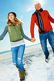 Happy young couple enjoying their winter vacation on snow