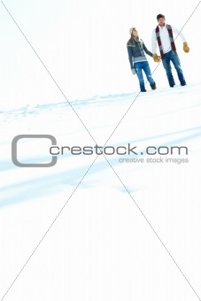 Young couple standing together on snow