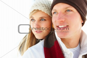Closeup of a attractive young couple looking away