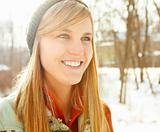 Beautiful happy young woman wearing a winter cap