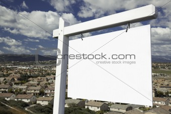 Blank Real Estate Sign with Elevated Housing Community View - Ready for your own message.