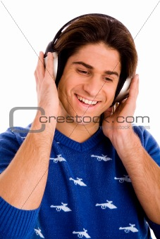 portrait of smiling man listening music