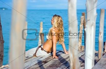 Blonde on pier