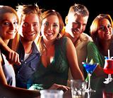 Group of young people enjoying cocktails