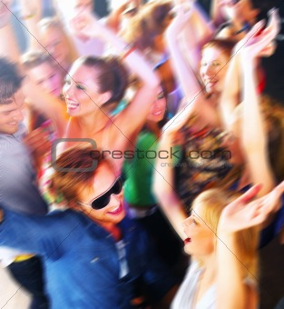 Group of people dancing in a bar or nightclub at a party