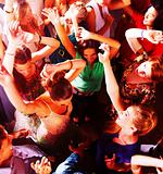Top view of a group of people dancing in a bar or nightclub at a party