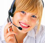 A smiling cute young blond wearing headset over white background