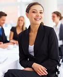 Happy young attractive business woman in a meeting