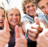 Happy guys and girls expressing happiness by showing thumbs up while smiling