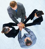 Business people with hands on top of each other. Symbolic picture