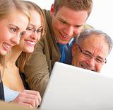 Closeup portrait of a business team working on a laptop