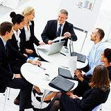 Group of business people having a meeting in the board room
