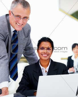 Two contemporary business people with a laptop