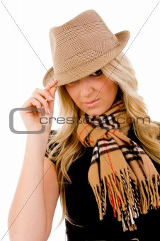 portrait of smiling young woman holding her hat
