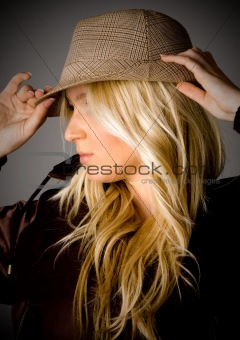 portrait of smiling young female holding her hat