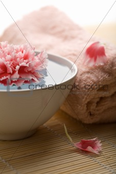 body care - towel and flower in bowl