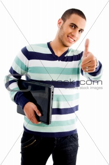 smiling boy with laptop and thumbs up