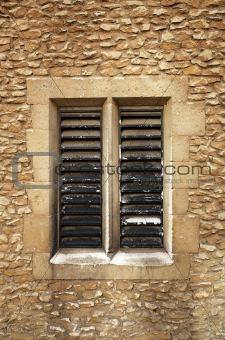 Slatted window in sandstone blocks