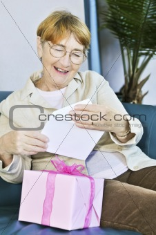 Old woman opening present
