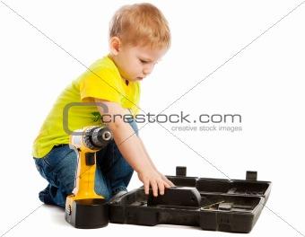Boy, box and screwdriver