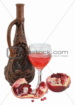 Glass of wine, bottle and a red pomegranate