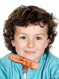 Child eating a sausage