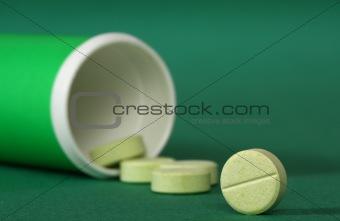 Medicine pills spilling from a bottle