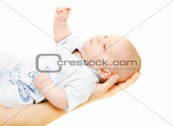 baby on parent's hands over white