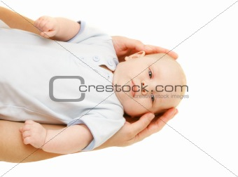 baby in parent's hands over white