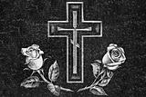cross and roses on a granite gravestone