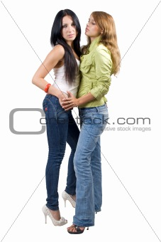 Two playful beauty young women. Isolated on white background