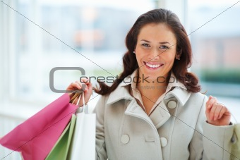 Attractive young lady holding shopping bags