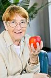 Elderly woman with apple