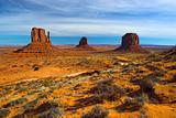 Red rock - semi-desert and the red rock of the Monument Valley with on the background of the famous table mountains