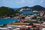 Tropical town - tropical island with a small red-roof town with the background of the large cruise ship