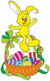 Easter bunny sitting on a basket