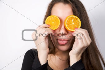 Portrait of beautiful young woman holding orange fruit